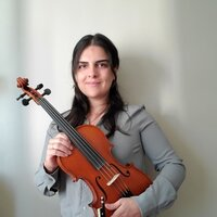 Music student gives violin lessons in person and on line in Calgary