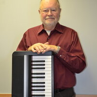 Music Teacher offers lessons on piano/keyboard, theory, guitar both electric and acoustic.
